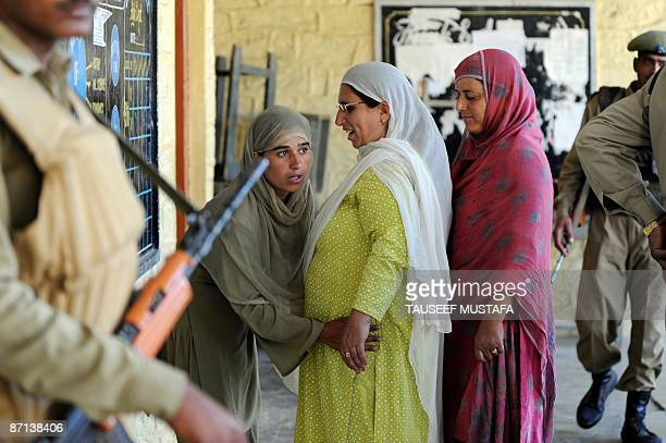 An Indian police woman frisks a Kashmiri woman voter prior to her casting her vote at Handwara on May 13 2009 Heavy security marked voting in a...