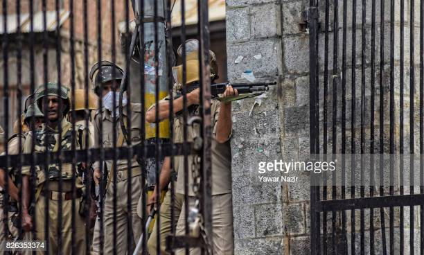 An Indian policeman fires metal pellets at Kashmiri Muslim protester outside Kashmir's grand mosque during an antiIndia protest on August 04 2017 in...