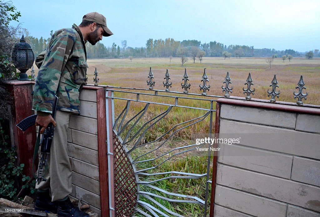 An Indian policeman guards the scene of a shooting incident outside Hotel Silver Star on October 19, 2012 on the outskirts of Srinagar; the summer capital of Indian administered Kashmir, India. Police reports stated that one person was killed while two were critically wounded when suspected militants opened fire near a hotel on the outskirts of Srinagar city. Lashkar-e-Toiba, a Pakistan based militant group battling Indian rule in Kashmir, has claimed the responsibility for the attack on the hotel in which a bellboy was killed and two other staffers were injured.