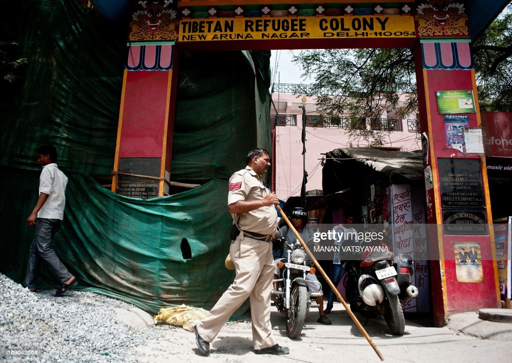 An Indian policeman keeps watch at the Tibetan refugee colony of Majnu Ka Tilla in New Delhi on May 19, 2013. Chinese Premier Li Keqiang arrived in India Sunday afternoon on the first stop of his maiden foreign trip, for talks on issues ranging from an unresolved border dispute to a festering trade-imbalance.