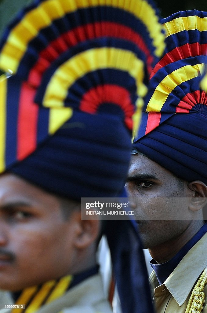 An Indian policeman looks on during a guard of honour at a memorial for police and uniformed personnel who lost their lives in 2008 terror attacks in Mumbai on November 26, 2012. A total of 166 people were killed and more than 300 others were injured when 10 heavily-armed Islamist militants stormed the city on November 26, 2008, attacking a number of sites, including the city's main railway station, two luxury hotels, a popular tourist restaurant and a Jewish centre. AFP PHOTO/ INDRANIL MUKHERJEE