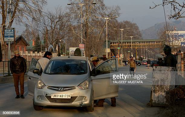 An Indian policeman searches a car during search operations in Srinagar on January 25 ahead of the country's Republic Day celebrations Indian troops...