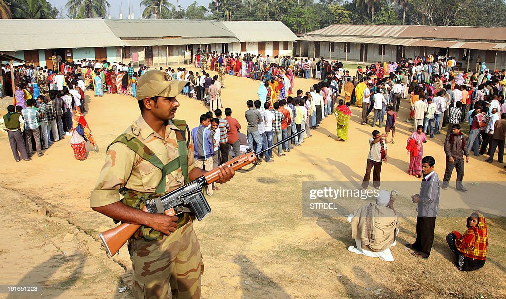 An Indian policeman stands guard at a polling station at Agartala the capital of the northeastern state of Tripura on February 14, 2013. Election to the 60-member state assembly in Tripura, in which the Left Front party is hoping to return to power for a record fifth time, began early today on a peaceful note amidst tight security, official sources said.