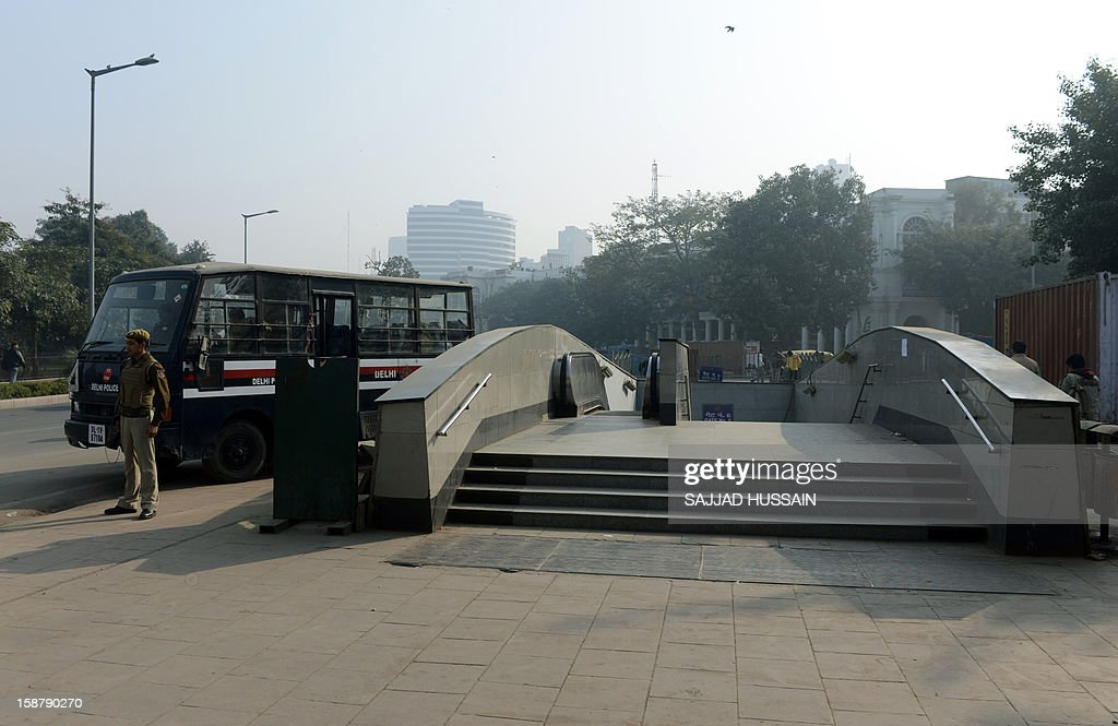 An Indian policeman stands guard outside the entrance to a closed metro station in New Delhi on December 29, 2012, as Indian leaders appealled for calm fearing fresh outbursts of protests after the death of a gang-rape victim. New Delhi's top police officer and chief minister have urged people to mourn the death of a gang-rape victim in a peaceful manner as large parts of the city-centre were sealed off. The calls for calm came after an Indian woman who was gang-raped on a New Delhi bus died in a Singapore hospital after suffering severe organ failure.