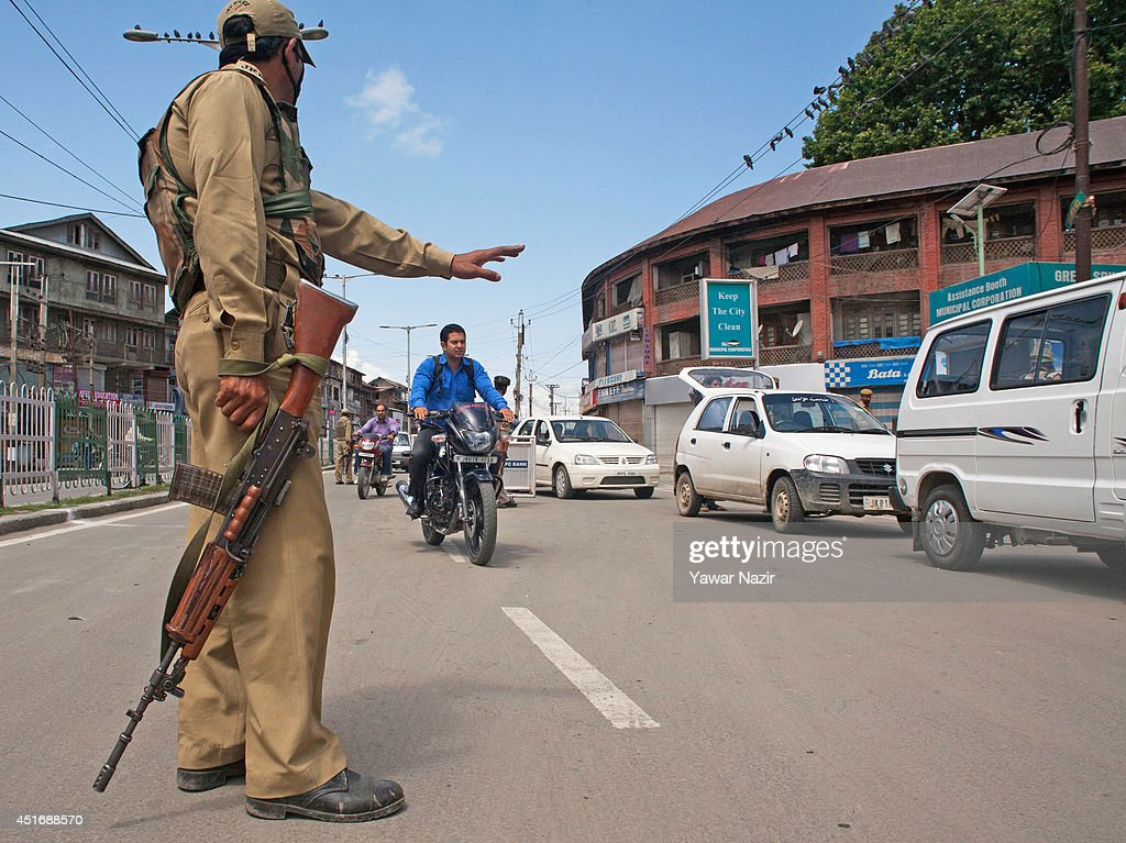 An Indian policeman stops a motorcyclist 2in the city centre during a strike against Indian Prime Minister Narendra Modi's visit on July 4, 2014, in Srinagar,the summer capital of Indian administered Kashmir, India. India's newly elected leader, Prime Minister Narendra Modi made his first official trip to Indian-controlled Kashmir, India's only Muslim-majority state, where separatist groups called a strike that closed down shops, businesses, schools, and all traffic. Disputes arose from Prime Minister Narendra Modi's inauguration of a railway line and a plan to review security and development in the Himalayan region dividing India and Pakistan. Reports stated that the restrictions were imposed to prevent any violent protests by separatist groups who oppose Indian rule.