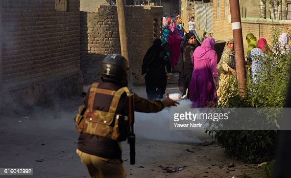 An Indian policeman throws a teargas canister at the Kashmiri Muslim women after they were shouting anti Indian slogans during an antiIndia protest...