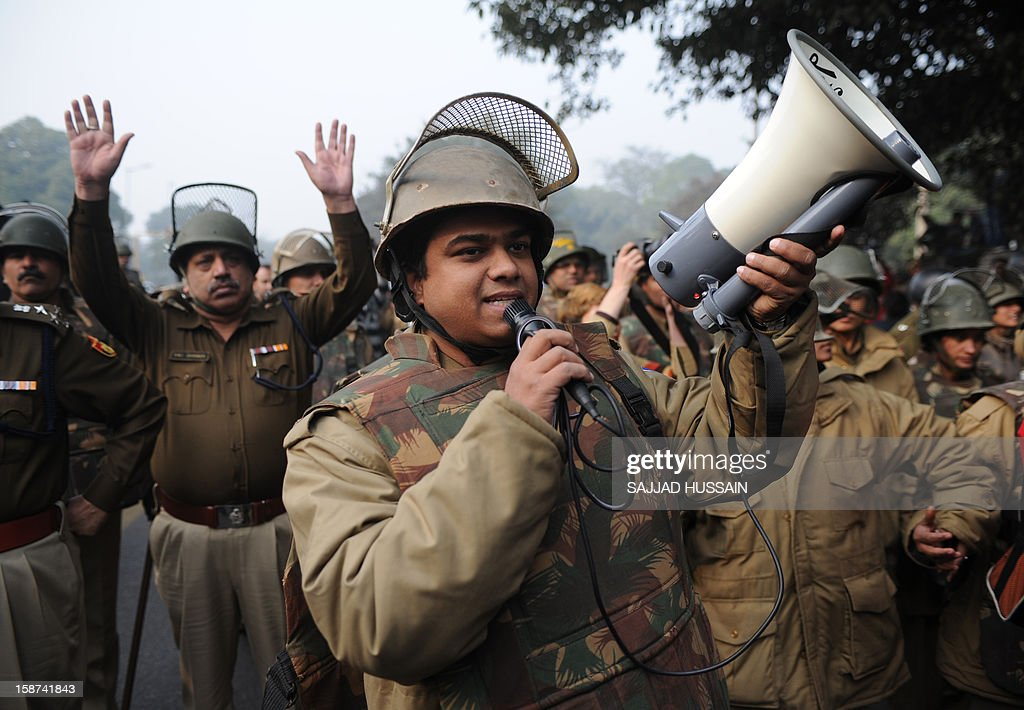 An Indian policeman uses a megaphone to direct demonstrators as they move towards India Gate in New Delhi on December 27, 2012, during a protest calling for better safety for women following the rape of a student in the Indian capital. Protests across India over the last week against sex crimes have denounced the police and government, with the largest in New Delhi at the weekend prompting officers to cordon off areas around government buildings. One policeman was killed and more than 100 people injured in the violence.