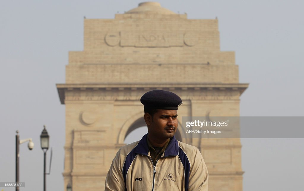 An Indian policemen looks on as he and others block a road leading to the India Gate Monument in New Delhi on December 31, 2012. The family of an Indian gang-rape victim said they would not rest until her killers are hanged as they spoke of their own pain and trauma over a crime that has united the country in grief.