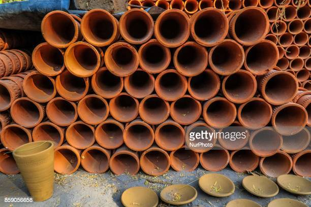 An Indian potter makes earthen lamps and other items ahead of Diwali festival in JaipurRajasthan India 08 Oct2017 People buy earthen lamps to...