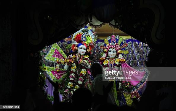 An Indian priest performs evening prayer on the occasion of 'Krishna Janmashtami' celebrations at the Iskcon temple in Allahabad on September 5 2015...