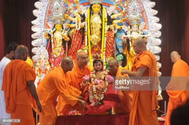 An Indian priest worships fiveyear old Hindu girl dressed as the Hindu goddess Durga at a Belur Math for the 'Kumari' puja rituala This year also...
