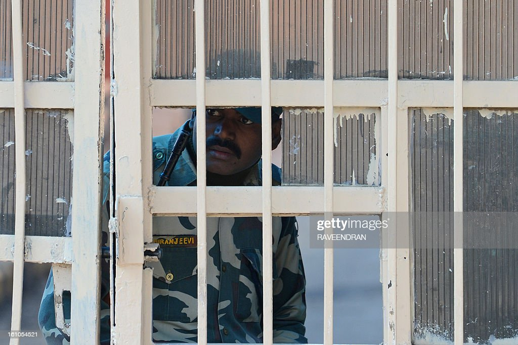 An Indian prison guard looks on from a gate at Tihar Jail, where Mohammed Afzal Guru was reportedly hanged earlier this morning, in New Delhi on February 9, 2013. A Kashmiri separatist was executed Saturday over his role in a deadly attack on parliament in New Delhi in 2001, an episode that brought nuclear-armed India and Pakistan to the brink of war.