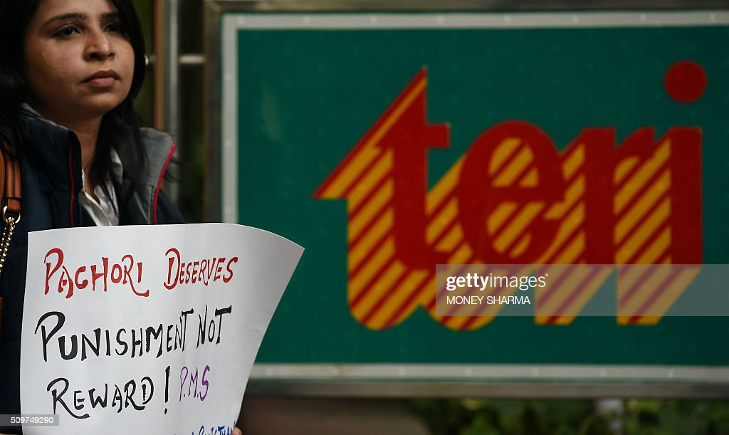 An Indian protester holds a placard during a protest outside The Energy and Resources Institute (TERI) office against the Vice-Chairman R. K. Pachauri in New Delhi on February 12, 2016. The TERI governing council has called for an urgent meeting to discuss Pachauri's position while awating a court decision on a year-old sexual harassment charge against him. AFP PHOTO / Money SHARMA / AFP / MONEY SHARMA