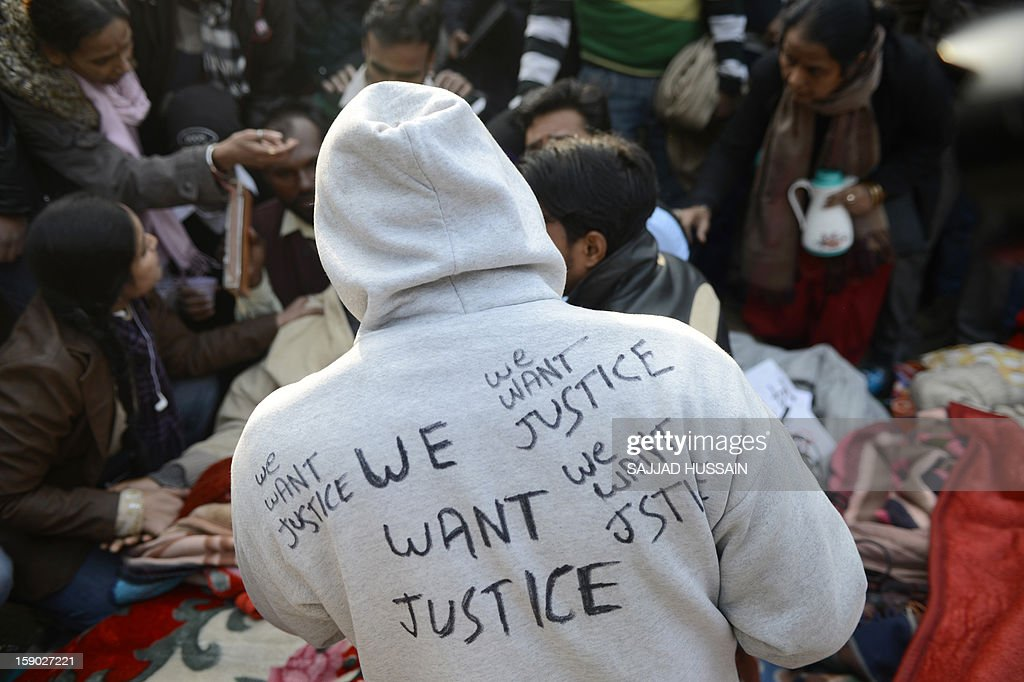 An Indian protester wears a jacket with slogans at Jantar Mantar during a protest against a gang rape in New Delhi on January 6, 2013. Claims of police incompetence and public apathy stirred new anger in the Delhi gang-rape case after the boyfriend of the victim recounted details of the savage attack for the first time. The man was the only witness to the gang-rape of his girlfriend by six men on a moving bus on December 16 which has stirred sometimes violent protests against the treatment of women in Indian society and an apparent rise in sex crime