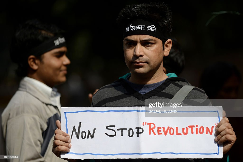 An Indian protestor holds a placard during a protest against last month's gang rape and murder of a student, in New Delhi on January 27, 2013. India's president on the eve of India's Republic Day celebrations said it was time for the country to 'reset its moral compass' in the wake of the savage gang rape and murder of a student last month that ignited nationwide protests.
