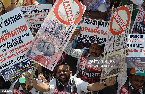TOPSHOT An Indian protestor holds placards of banned 500 and 1000 rupee notes during a protest against demonetisation in Mumbai on November 28 2016...