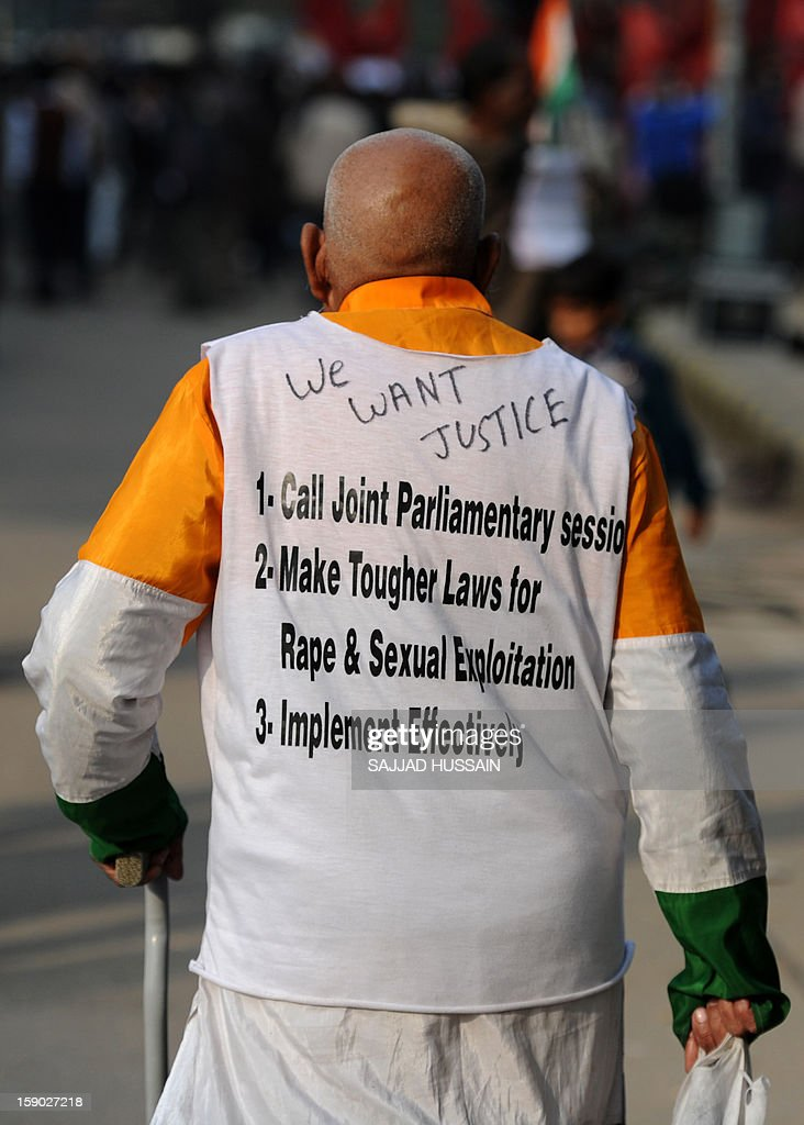 An Indian protestor walks at Jantar Mantar during a protest against a gang rape in New Delhi on January 6, 2013. Claims of police incompetence and public apathy stirred new anger in the Delhi gang-rape case after the boyfriend of the victim recounted details of the savage attack for the first time. The man was the only witness to the gang-rape of his girlfriend by six men on a moving bus on December 16 which has stirred sometimes violent protests against the treatment of women in Indian society and an apparent rise in sex crime