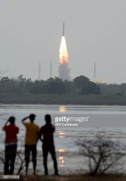An Indian PSLV rocket carrying an Earth observation satellite along with 30 other nano satellites launches from the Sathish Dawan Space Station at...