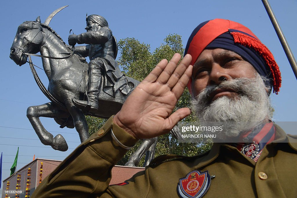 An Indian Punjab policeman poses at the memorial of General Sardar Sham Singh Attari at India Gate on the outskirts of Amritsar on February 10, 2013. Police personnel paid their respects during the 167th martyrdom day of the Sikh General.