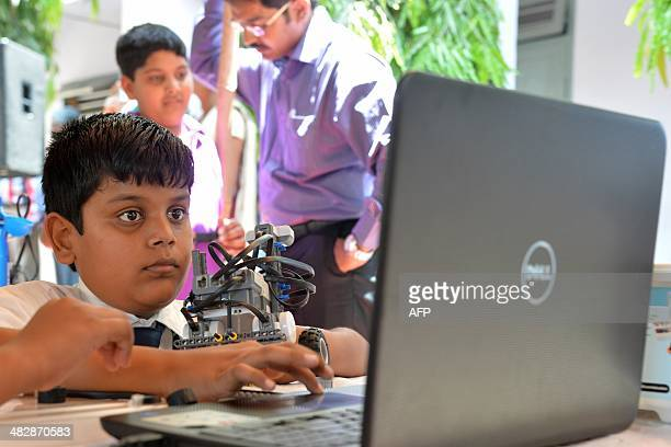 An Indian pupil programmes a robot using a laptop during the South Indian Zone Finals of the RoboCup Junior Competition in Bangalore on March 5 2014...