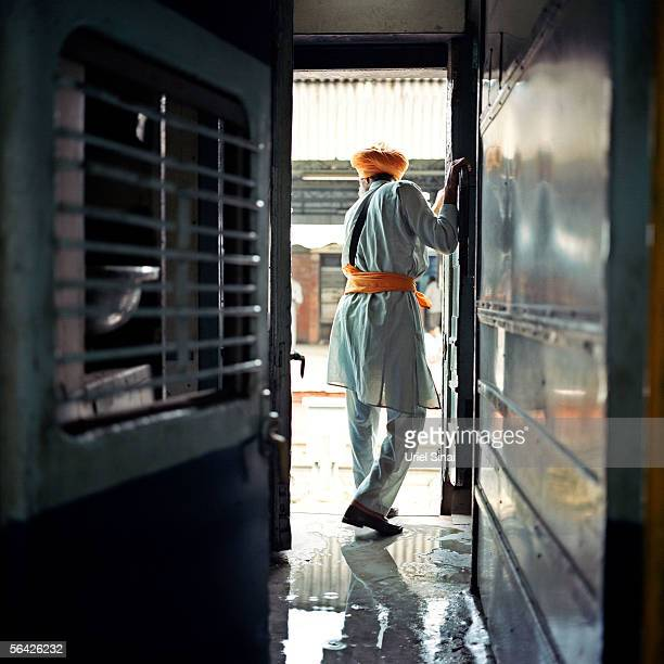 An Indian railway waits for his train to depart from central train station September 25 2005 in New Delhi India Although India occupies only 24% of...