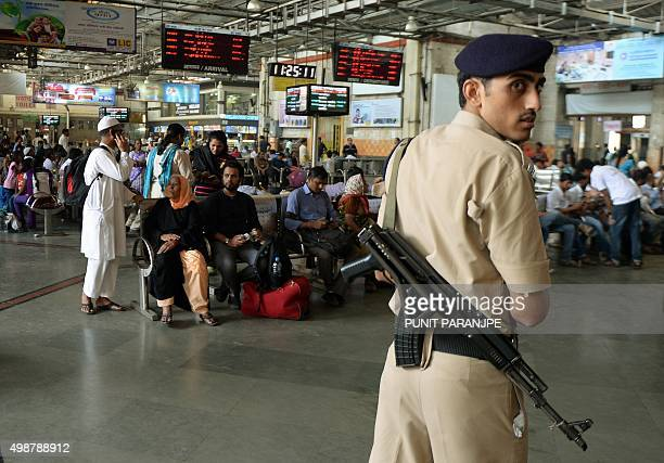 An Indian railway's police offical walks around at the Chattrapathi Shivaji Terminus railway station one of the 2008 militant attack sites in Mumbai...