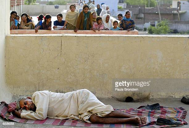 An Indian refugees sleeps at a school turned migrant camp in RS Pura on June 6 2002 in Jammu the winter capital of the disputed region of Kashmir...