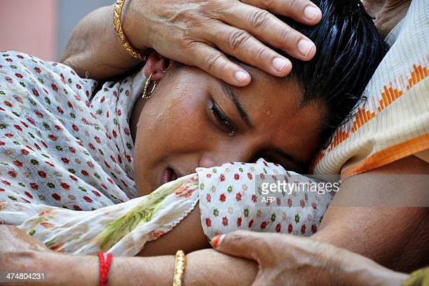 An Indian relative of activist Pranab Boro who died after selfimmolating during a protest mourns in Guwahati on February 25 2014 Boro an activist...