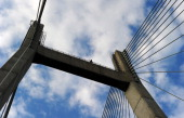An Indian resident gestures after climbing a bridge accross the Yamuna near Sangam in Allahabad on July 22 2014 Police detained the man after a...