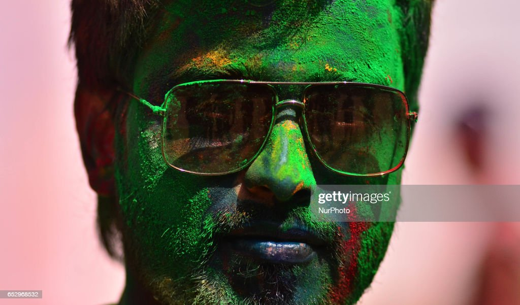 An Indian reveller smear with colour looks on during Holi celebration in Dimapur, India north eastern state of Nagaland on Monday, March 13, 2017. Holi, the festival of colours, is a riotous celebration of the coming of spring and falls on the day after full moon annually in March.