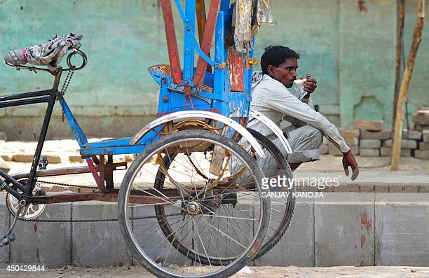 An Indian rickshaw puller quenches his thirst on a hot summer afternoon in Allahabad on June 11 2014 Temperatures across many parts of northern India...