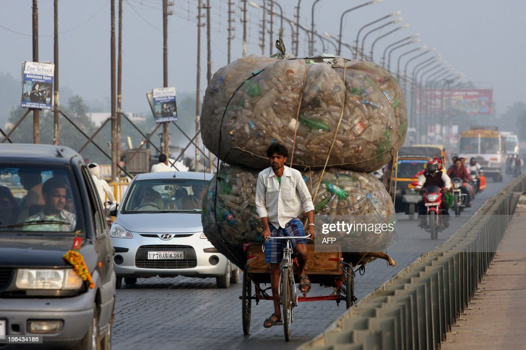 An Indian rickshaw puller transports discarded plastic bottles in Allahabad on November 15, 2012. Large sections of the 2,500-kilometre (1,500-mile) River Ganges, which runs through Allahabad and Hindus believe washes away all sins, are polluted by sewage, discarded garbage and factory waste as it crosses the northern Indian plains.