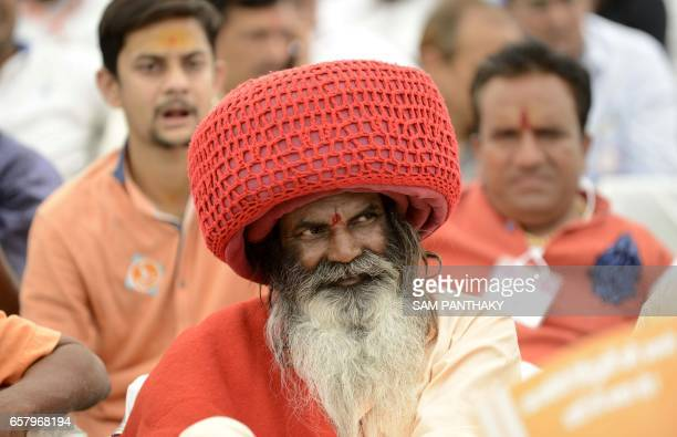 An Indian Sadhu looks on during a gathering of The Vishva Hindu Parishad at The GMDC grounds in Ahmedabad on March 26 which was addressed by VHP...