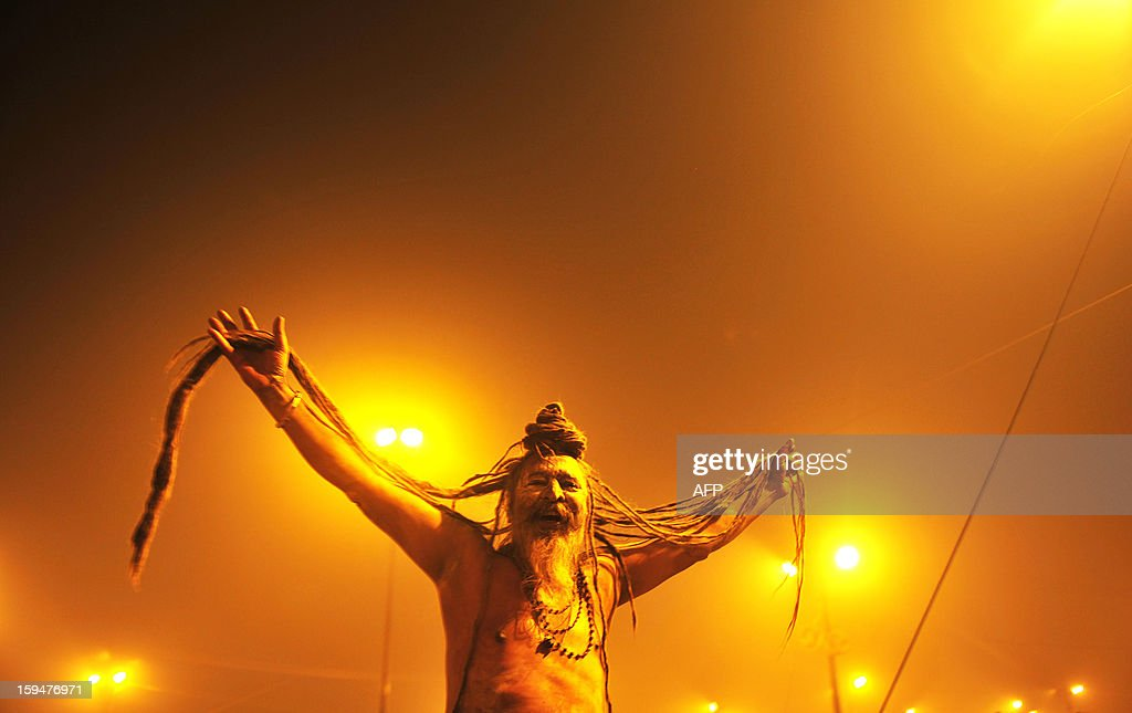 An Indian Sadhu or holy man shows off his long dreds during the Kumbh Mela in Allahabad on January 14, 2013. Hundreds of thousands of Hindu pilgrims led by naked, ash-covered holy men streamed into the sacred river Ganges at the start of the world's biggest religious festival. The Kumbh Mela in the Indian town of Allahabad will see up to 100 million worshippers gather over the next 55 days to take a ritual bath in the holy waters, believed to cleanse sins and bestow blessings. AFP PHOTO/ Sanjay Kanojia