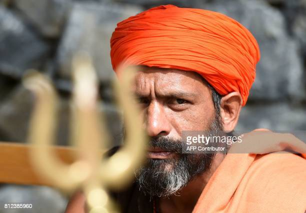 An Indian sadhu rests on the road at Chandanwari in Anantnag district some 115 km southeast of Srinagar during the annual Hindu pilgrimage to the...