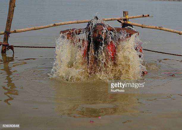 An indian sadhu takes a holy dip in river Ganges before Kanwar yatra during holy month of shravanain Allahabad on August 72015 as depart after...
