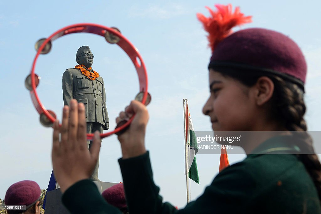 An Indian school band performs near the statue of freedom fighter, Netaji Subhash Chandra Bose in Amritsar on January 23, 2013, as part of celebrations for his 116th birth anniversary. Bose was a prominent Indian nationalist leader who attempted to gain India's independence from British rule by force during the waning years of World War II.