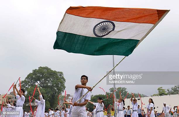An Indian schoolboy holds the tricolour during a rehearsal for Independence Day Parade celebrations at The Guru Nanak Stadium in Amritsar on August...