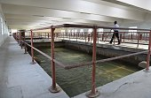 An Indian security guard walks inside the Bawana water treatment plant at Bawana in northern Delhi state on April 21 2015 Delhi chief minister Arvind...