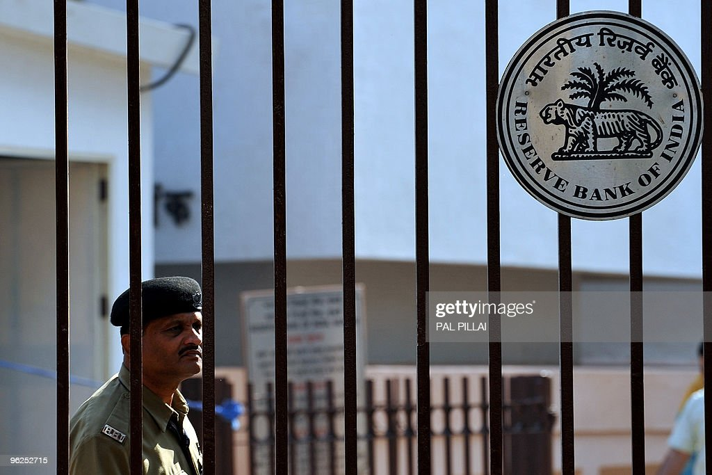 An Indian security officer stands guard at the gate to the Reserve Bank of India outside its headquarters in Mumbai on January 29 2010 India's...