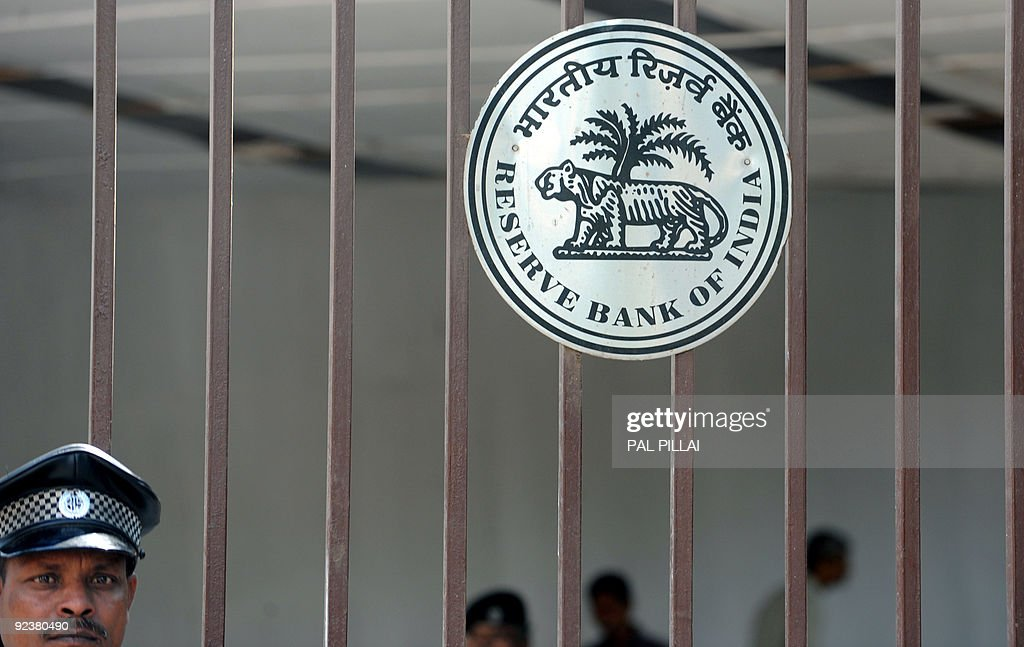 An Indian security officer stands guard at the gates to The Reserve Bank of India headquarters in Mumbai on October 27 2009 India's central bank held...