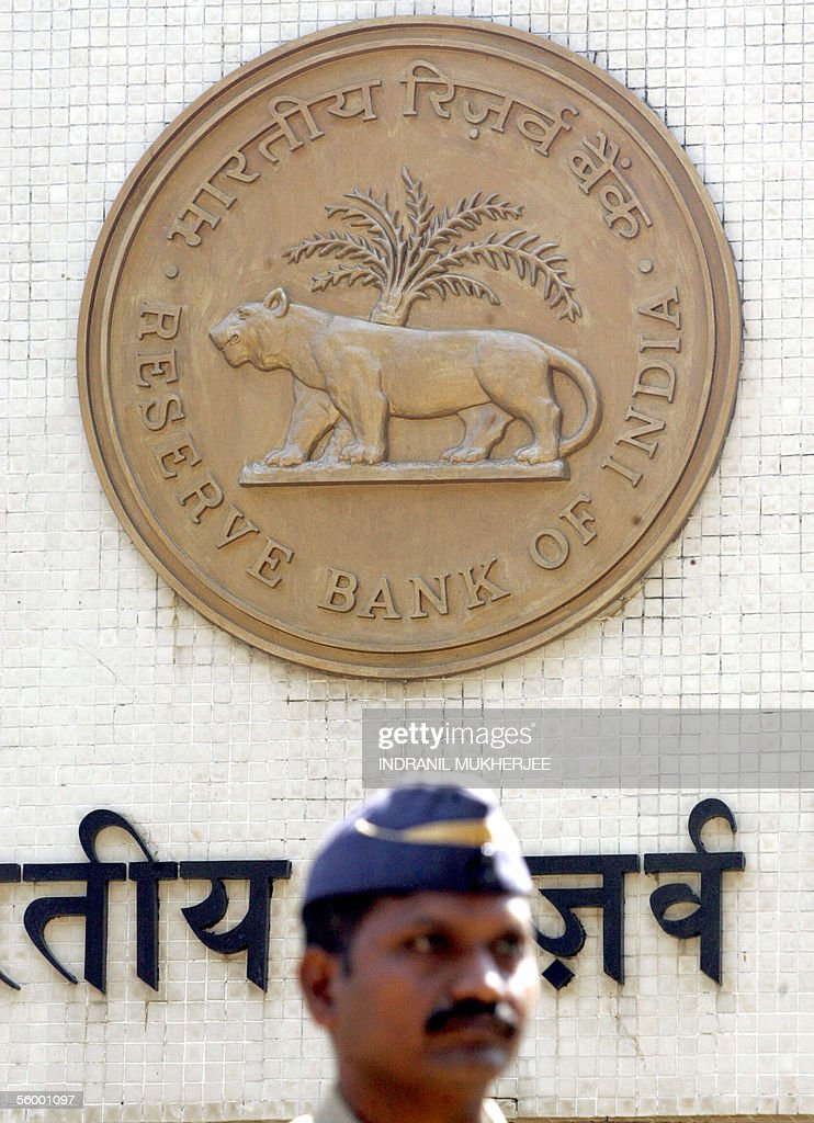 An Indian security officer stands guard outside the Reserve Bank of India headquarters in Mumbai 25 October 2005 The RBI After its midterm review of...