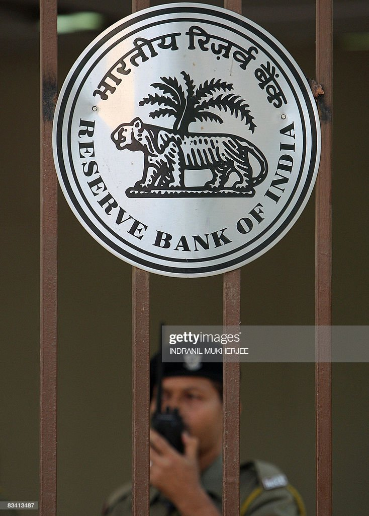 An Indian security official stands guard at the entrance to The Reserve Bank of India in Mumbai on October 24 2008 India's central bank kept its key...