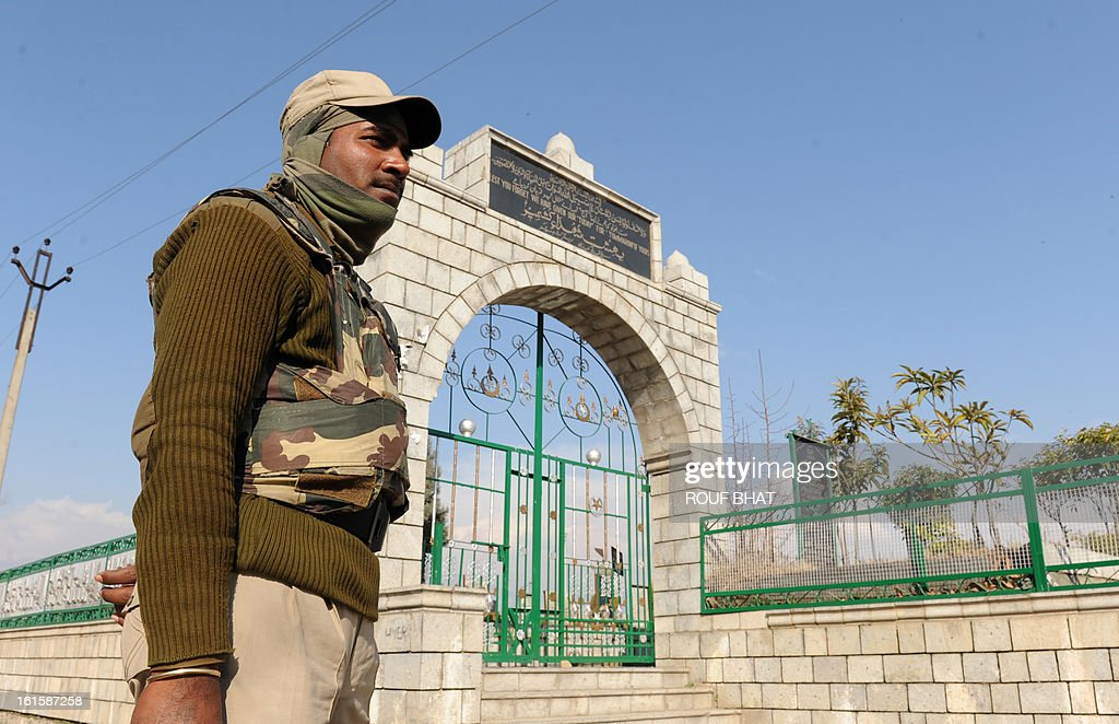 An Indian security official stands outside Martyres Graveyard where a tomb stone for Kashmiri separatist, Afzal Guru, was placed Srinagar on February 12, 2013. Guru, a Kashmiri separatist was executed on February 9, 2013 over his role in a deadly attack on parliament in New Delhi in 2001, an episode that brought nuclear-armed India and Pakistan to the brink of war. A former fruit seller, he was hanged at Tihar Jail on the outskirts of the capital after his final appeal for mercy was rejected by President Pranab Mukherjee. AFP PHOTO/ Rouf BHAT
