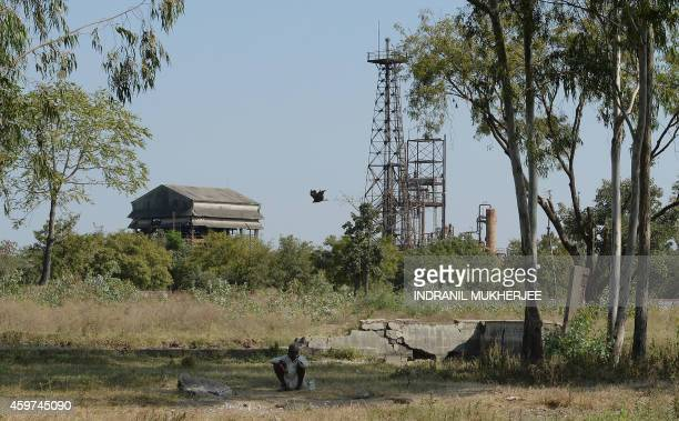 An Indian shepherd watches over livestock outside the Union Carbide factory in Bhopal on November 29 2014 Nearly deaf and riddled with cancer and...