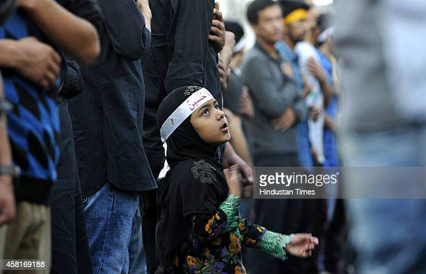 An Indian Shiite Muslim girl beating her chest during mourning procession on the seventh day of Muharram October 31 2014 in Jammu India The tenth day...