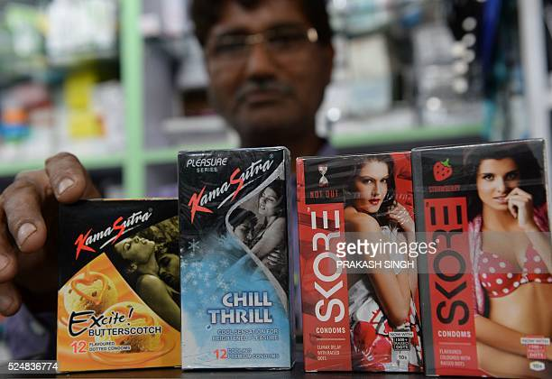 An Indian shopkeeper arranges condom packets at a chemist shop in New Delhi on April 27 2016 One of India's most senior lawyers has been ordered to...