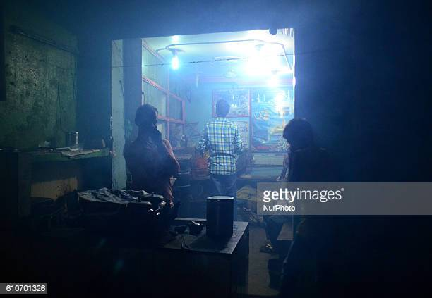 An Indian shopkeeper covers his mouth to prevent himself by smoke from fumigation in a busy old street of Allahabad on September 27201621 people died...