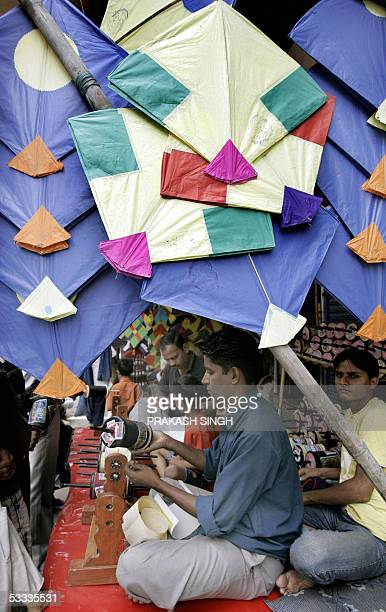An Indian shopkeeper sells kites and string ahead of India's Independence day celebrations in New Delhi 07 August 2005 Kite flying is a tradition on...