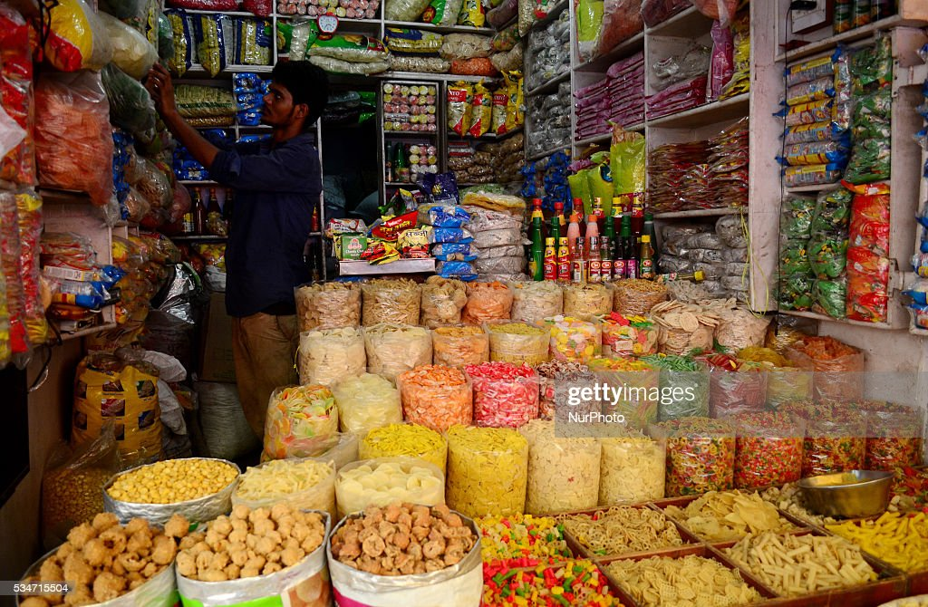 An indian shopkeeper sets sealed packets of cereals in a whole sale grocery shop, in old market of Allahabad on May 27,2016.A United nation's latest report has estimated that India could lose $49 billion (more than 3 lakh crore) of its GDP if global food prices double. India will see the second highest loss after china,which is estimated to lose $161 billion of its GDP because of volatile food prices. The report said the world is likely to suffer from more volatile food commodity prices because of several reasons, including climate change and rising populations.